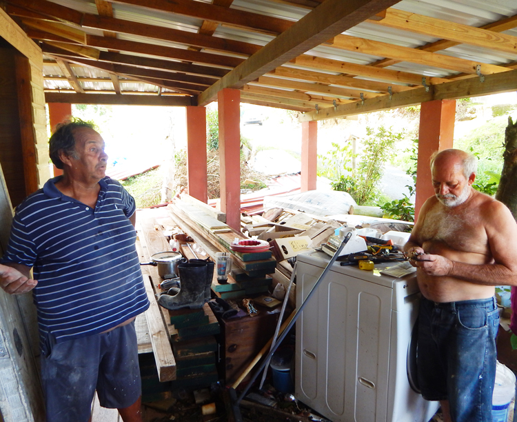 "Retired electrical worker Raúl Laboy, left, and Wilfredo Abreu, in Humacao, Puerto Rico, talk to Militant reporters. ""Social hurricane"" of capitalism is worse than natural one, Laboy said."