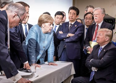 Donald Trump faces off with other government leaders during the G-7 summit in Quebec June 9. Meeting underscored fact that Washington is still world's dominant imperialist power.