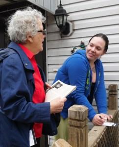 Helen Meyers, left, SWP U.S. Senate candidate in Minnesota, talks with workers going door to door in Maplewood May 12.