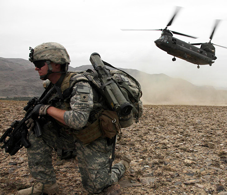 U.S. soldier in Afghanistan in 2010. Washington is moving to negotiate ways to pull back from bloody wars it has failed to win there and in Mideast.