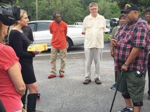 Marion Payne, fired DeKalb County, Georgia, school bus driver, speaks at July 20 press conference. Payne is one of several drivers fired after drivers got sick over pay and work conditions.