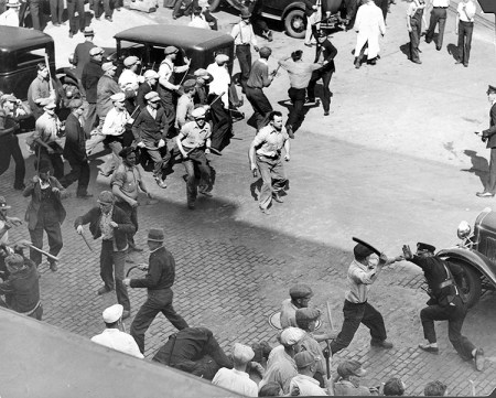 """Above, workers fight off assault by police and national guard in May 1934 Teamster strike. In 1941 trial of revolutionary Teamster and Socialist Workers Party leaders, prosecutor asked James P. Cannon if this fight against the deputies """"was the kind of violence SWP advocated."""" The deputies """"were organized to drive workers off the streets. They got a dose of their own medicine,"""" Cannon said. """"I think workers have a right to defend themselves. If that is treason you can make the most of it."""""""