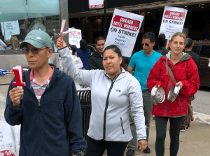 "Hotel workers on strike in Chicago picket Hyatt Regency Sept. 7. ""We need health insurance no matter what our hours were the previous months,"" waitress Rafaela Sandoval told the Militant."