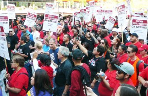 """Thousands of hotel workers on strike in Chicago march through city demanding new contract. """"Hotel owners say we don't work enough hours to get health insurance,"""" said housekeeper Laura McKinney at the demonstration. """"That's the main reason we're on strike."""""""