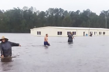 Farmworkers at Riggs Brothers Farm in Kinston, North Carolina, called 911 Sept. 15 to ask for help when they woke up in water waist deep. Owner called authorities, said everything was fine, emergency officials cancelled rescue. It was hours before anyone came to get them out.