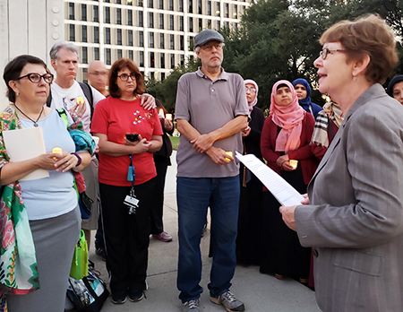 """Alyson Kennedy, SWP candidate for U.S. Senate from Texas, speaking at vigil in Dallas protesting anti-Semitic attack in Pittsburgh. """"Unions should speak out against Jew-hatred,"""" she said."""