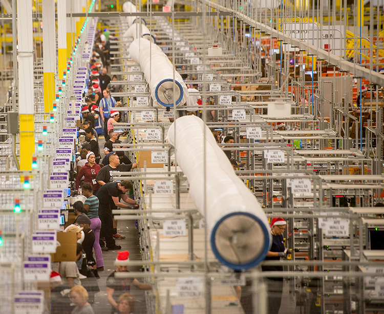 Amazon warehouse running in Tracy, California, 2014. Bosses installed robots as they expanded hiring. In face of speedup, boss harassment, unsafe conditions workers need a union.