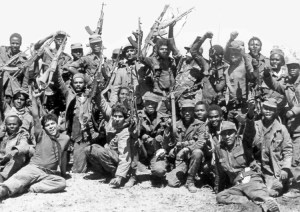 """Cuban and Angolan fighters celebrate 1983 battle in Cangamba, Angola, pushing back forces backed by apartheid South Africa and U.S. rulers. """"This internationalist mission in Angola"""" Castro said, victorious in 1988, """"had a very big impact on Africa,"""" helping lead to fall of the apartheid regime."""