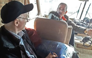 "SWP member Joel Britton, left, talks with carpenter Tony Worino in his RV at fire refugee center in Chico, Calif. ""How do the rich control everything and manipulate us?"" Worino asked."
