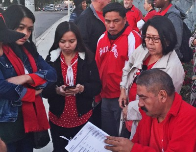 Teachers in Los Angeles review proposed contract before vote after six-days on strike Jan. 22.