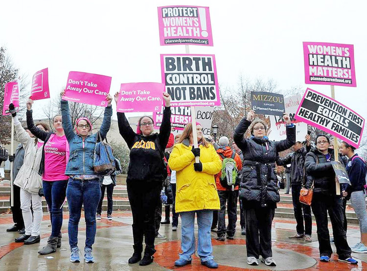 Protesters at University of Missouri demonstrate in 2015 in support of women's right to abortion, demanding university hospital executives reverse decision to cut off admitting privileges for doctors who perform abortions at Planned Parenthood clinic in Columbia, Missouri.