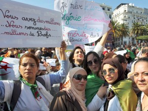 """Teachers hold placards outside Algiers post office March 13, reading at left, """"You have millions. We are millions of teachers"""" and in center, """"I dream of a democratic Algeria."""""""