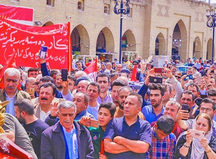 "May Day march in Erbil, Kurdistan. Banner demands the government provide jobs. Other banners demanded, ""Kurdistan Regional Government must recognize workers' rights in law!"""