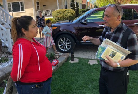 """Dean Hazlewood with Patricia Flores May 4 in Blue Island, Illinois. Hazlewood agreed with Flores when she said, """"U.S. troops wouldn't help people in Venezuela."""""""