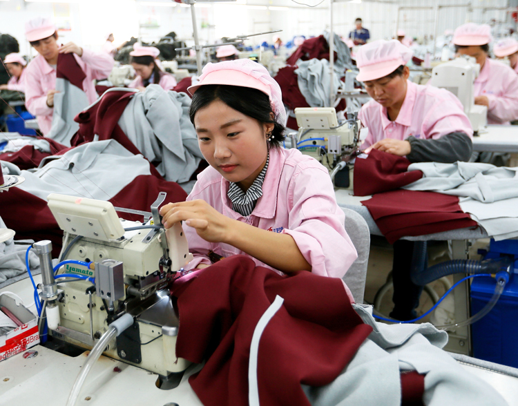 """Garment workers in Heze, China, in 2018. The industrial workforce is """"the class that is the foundation and special product of capitalism,"""" writes SWP leader George Novack. It is also """"destined to take charge of the economy and remodel society from top to bottom."""""""