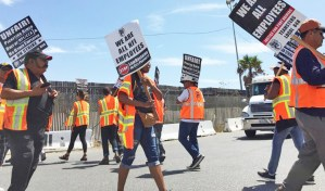 "Truck drivers picket in Wilmington, California, Sept. 9, demanding NFI company bosses treat them as workers, not ""contractors."" Farrell Dobbs explains how owner-operators, loaded by debt, are also exploited workers."