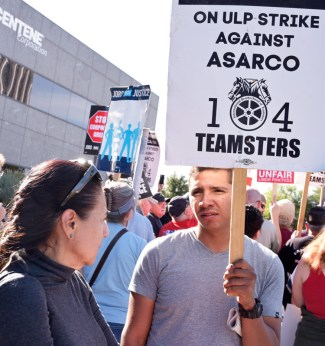 Roberto Banegas, a heavy equipment operator at Asarco's Mission Mine in Arizona, on strike for pay raise and against company effort to break union, talks with Socialist Workers Party member Ellie Garcia at solidarity rally in Tucson, Nov. 18.
