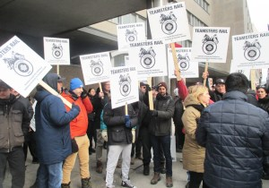 More than 50 Teamster rail strikers picket Canadian National headquarters in Montreal Nov. 26 before tentative agreement was announced. Now debate over contract begins before vote.