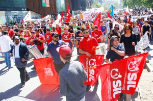 Union contingent of Walmart workers at Oct. 23 march in Santiago, Chile, part of nationwide general strike protesting low wages, woefully inadequate pensions and health care.