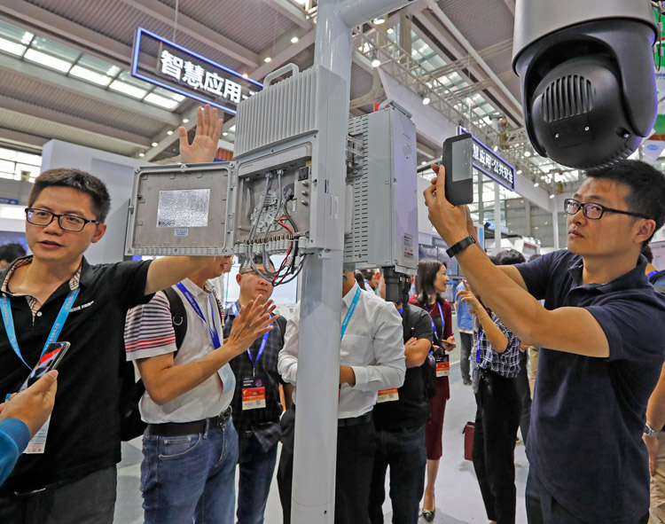 Huawei display of 5G mobile station at China Expo in Shenzhen, Oct. 29, 2019. Beijing seeks to use high-tech dominance to help establish long-term bloc with reliant Asian regimes.
