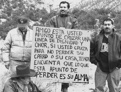 """Strike pickets at Co-Op coal mine in Huntington, Utah, December 2003. Sign says: """"If you cross to avoid losing your car or your house, keep in mind that what you are about to lose is your soul."""" The strikers, mostly Mexican immigrants, won solidarity from workers across the United States."""