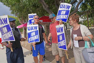 SWP candidates for president, Alyson Kennedy, right, and vice president, Malcolm Jarrett, left, join autoworkers' picket line in Arlington, Texas, during GM strike in September 2019.