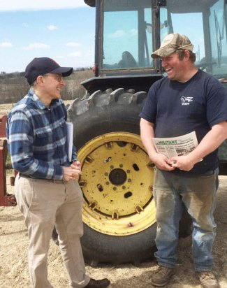 """David Rosenfeld, left, SWP candidate for Senate in Minnesota, and Darin Von Ruden, president of Wisconsin Farmers Union, on Ruden's farm. Von Ruden subscribed to Militant, purchased Red Zone: Cuba and the Battle Against Ebola in West Africa. """"Capitalism doesn't work well for health care, food,"""" he said."""