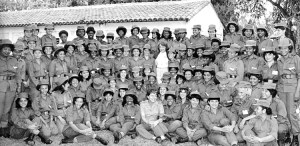 Members of Cuban Women's Antiaircraft Artillery Defense Regiment leaving for Angola in 1988, to help defeat apartheid South Africa's invasion. Vilma Espín, leader of Federation of Cuban Women, at center in white blouse.