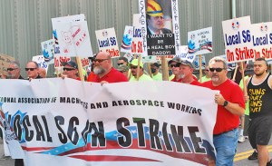 """Shipyard workers on strike in Bath, Maine, and supporters march July 25 against company demands to expand subcontracting, cut back seniority rights and raise health care costs. """"This is not about greed on our part,"""" said striker John LaPointe. """"It's about dignity,"""" and knitting together generations of workers."""