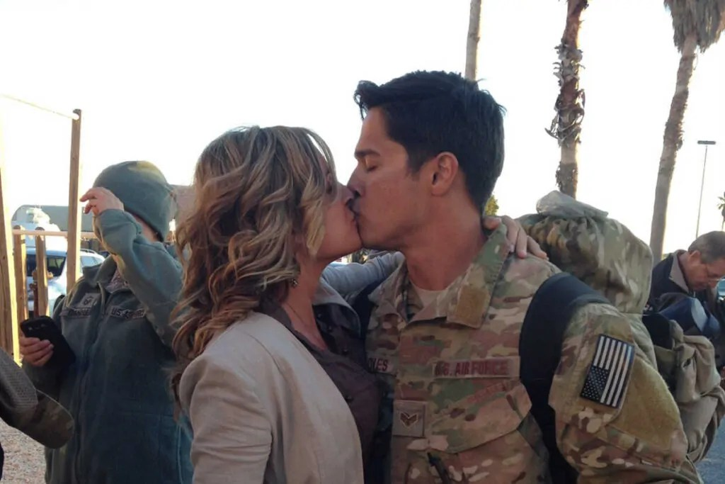 Military couple in a relationship kissing