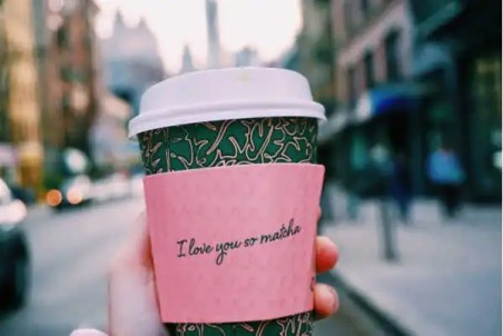 """Coffee cup with sleeve that reads """"I love you so matcha."""""""