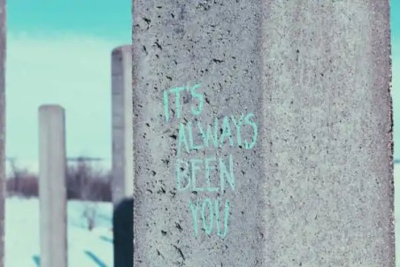 Graffiti art on concrete pillar that reads