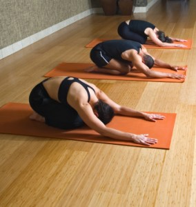Three people doing a yoga pose
