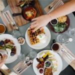 Overhead view of people eating breakfast
