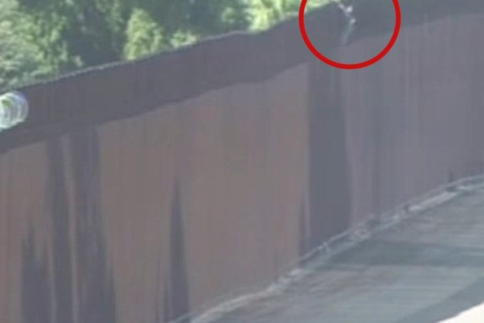 Smuggler carries girl over 30-foot US border wall then returns to Mexico