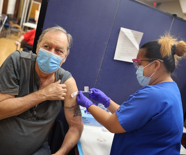Enforcing Biden's COVID Vaccine Mandate Could Prove Challenging