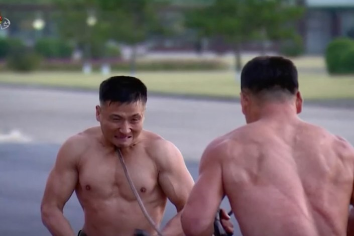 Kim Jong Un enjoys bizarre display of force by shirtless soldiers