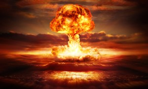 Nuclear bomb explodes in the desert.