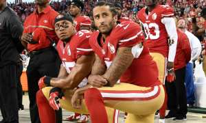 Colin Kaepernick peacefully protests police brutality in America by kneeling during the pledge of allegiance.