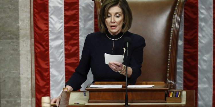 House Speaker Nancy Pelosi of Calif., readies to strike the gavel as she announces the passage of article II of impeachment against President Donald Trump, Wednesday, Dec. 18, 2019, on Capitol Hill in Washington. (AP Photo/Patrick Semansky)