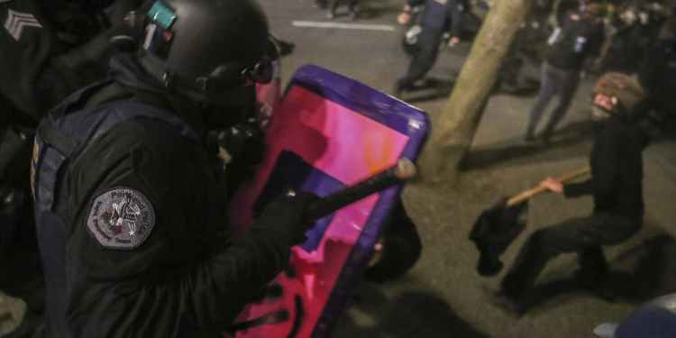 Portland protesters set fire to the city's police association building