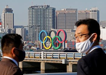 How is Japan working to host a COVID-free Olympics this summer?