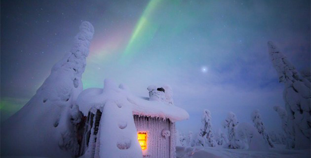 Artist Takes Magical Photos Of Finnish Winters Under The Northern Lights