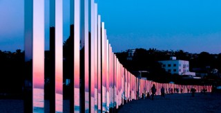 Laguna Beach Art Installation Sees a Quarter Mile of Mirrored Poles that Catch Stunning Reflections