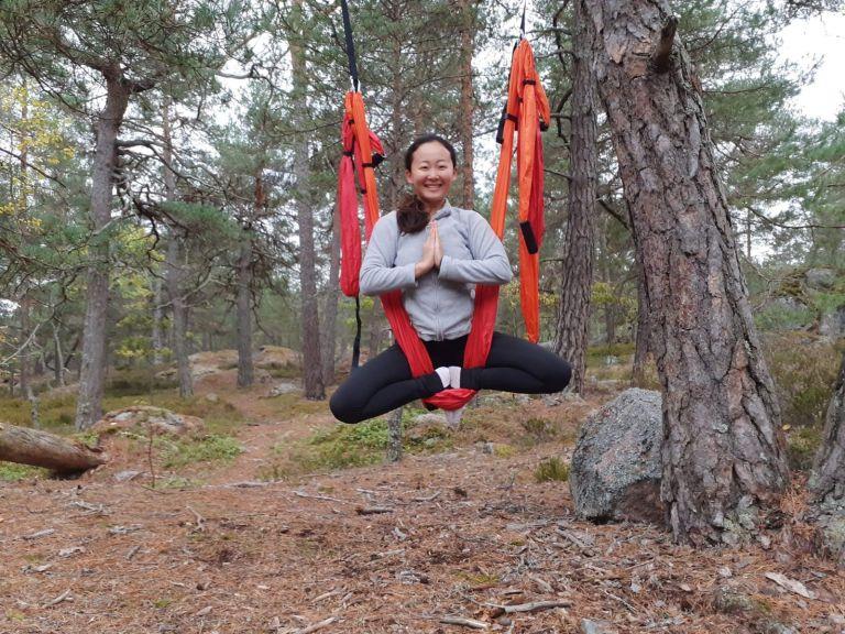 Shinrin-yoku in Nacka a woman doing aerial yoga