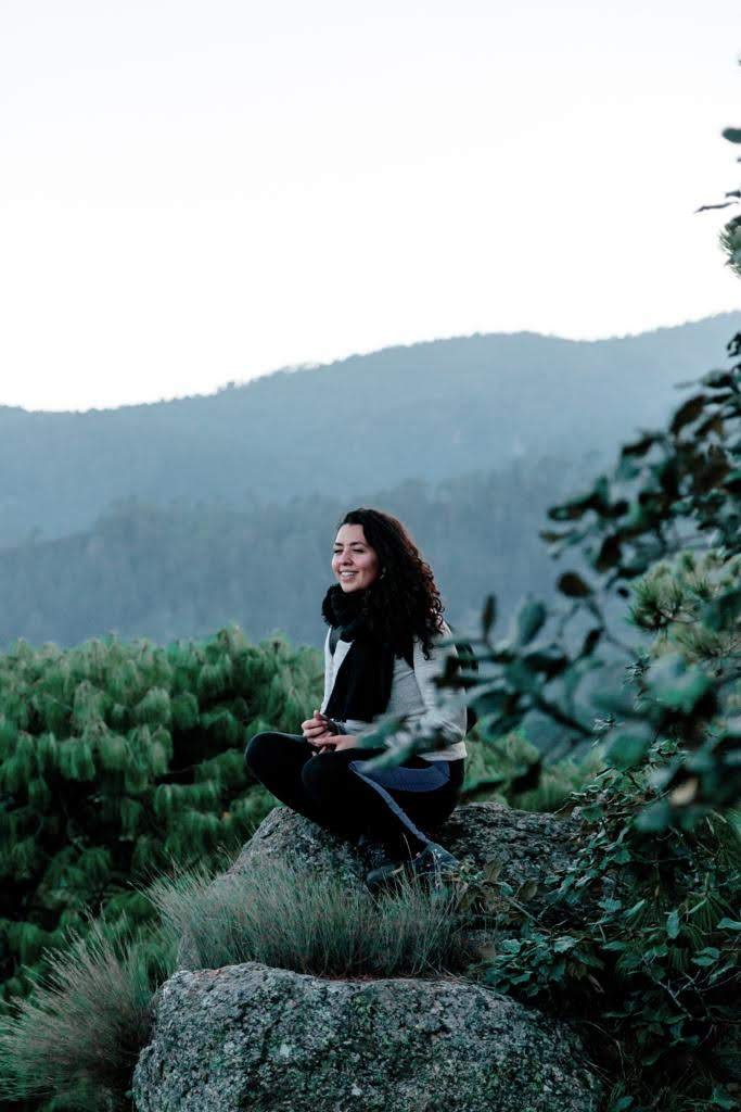 A woman sitting quietly amid nature