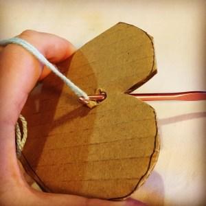 woollen hearts and crochet hook