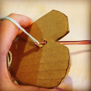 woollen hearts and crochet hook