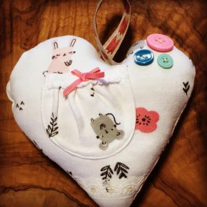 old baby clothes create zero waste baby shower gifts or keepsakes