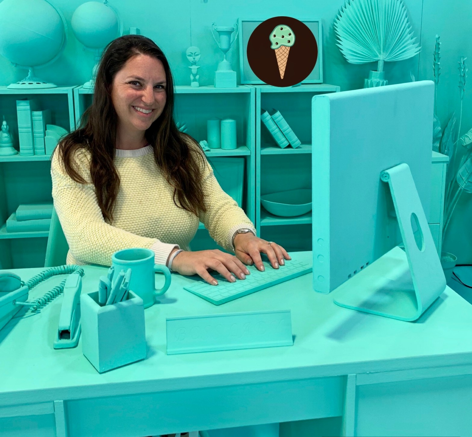 The Mint Chip Mama at a computer pretending to write a parenting blog. Everything is painted turquoise. Long Island Mom Blog